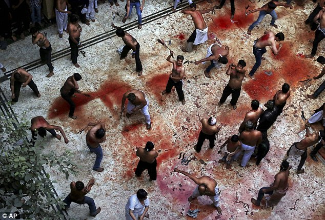 The bloody floor of a mosque in New Delhi, India, as Shiite Muslims flagellate themselves today during a Muharram procession marking Ashura