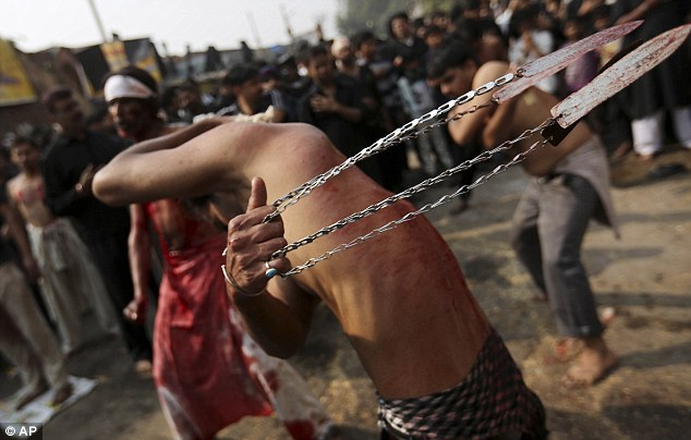 Shiite Muslims flagellate themselves during a Muharram procession