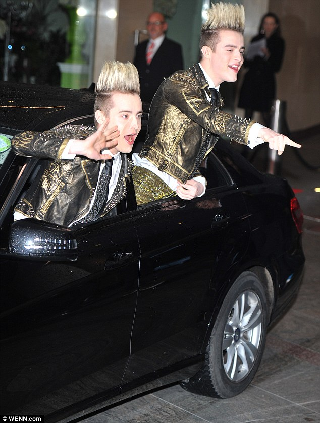 Making an entrance: Jedward twins John and Edward Grimes drew attention from the crowd outside the venue by hanging out the windows of their car and waving to fans