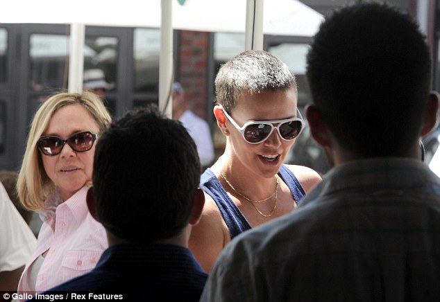 South African celebrity: The Oscar winner chats to some fans as her mother Gerda proudly looks on