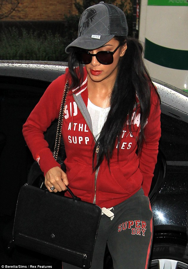 Urban chic: Nicole kept it casual in a red zip-through hood jumper, baseball cap and black tracksuit trousers as she arrived at X Factor rehearsals on Monday