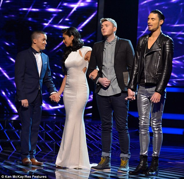 Tough times: Rylan, James and Jahmene seemed very nervous as they awaited the results of the public vote