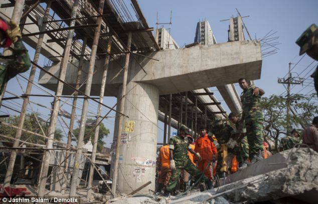 Search and rescue: At least 20 people are said to still be trapped in the rubble after the concrete overpass collapsed