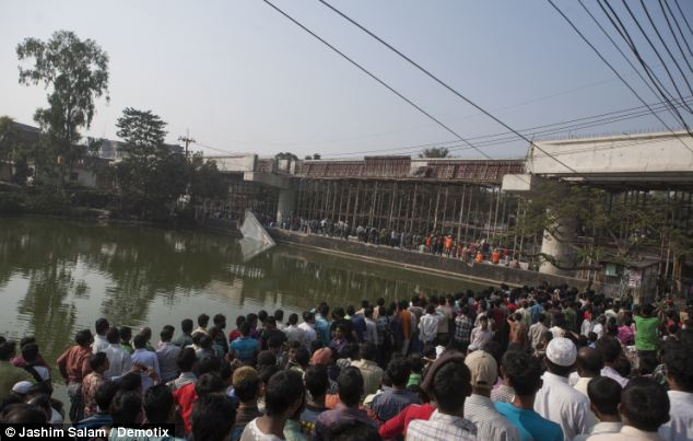 Helpless: Hundreds of onlookers close to the overpass where three concrete beams collapsed