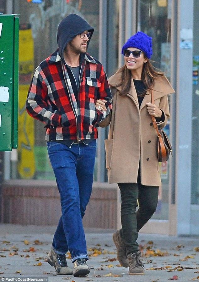 Still smitten: Ryan Gosling and girlfriend Eva Mendes stroll through New York on Thanksgiving morning