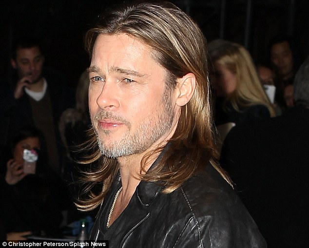 Brad to the bone: The scruffy movie legend stepped out to a Killing Me Softly in New York sporting shiny long hair, reminiscent of his youth