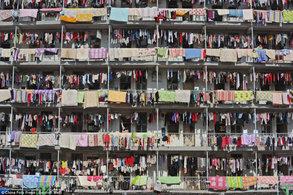 Rainbow of washing: Sheets and clothes are hung out to dry in the sun at Hubei University of Traditional Chinese Medicine