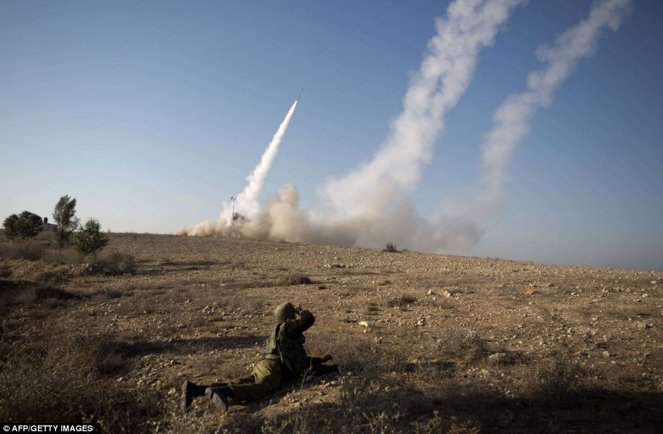 The Israeli military launch a missile from the Iron Dome air defence system, designed to intercept and destroy incoming short-range rockets and artillery shells from the Gaza Strip