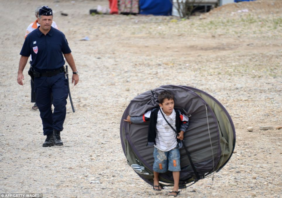 A child from the Roma community leaves a camp after being expelled by French police officers in Saint-Priest, outside Lyon, last August