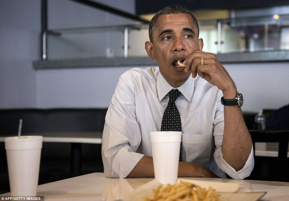 President Obama tucks into some dinner while meeting with supporters in Florida last September