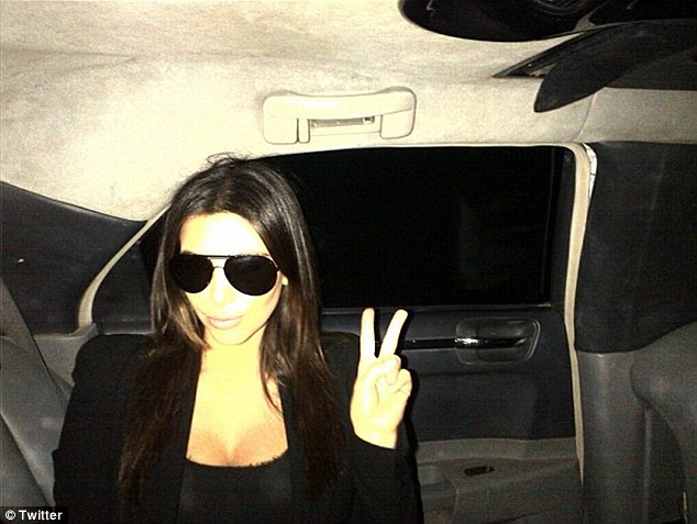 Milkshake mission: Kim Kardashian pulls a peace sign, tweeting a snap of herself having arrived in Kuwait. The TV star is in the Middle East to brush up on her political knowledge and open two Millions Of Milkshakes shops