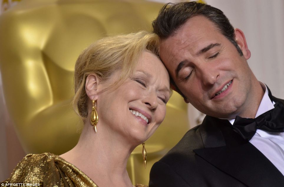Meryl Streep and Jean Dujardin celebrate their Oscar success in the press room at the 84th Annual Academy Awards in Hollywood in February