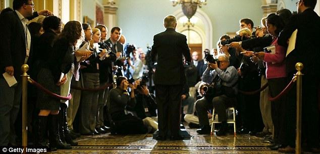 Press call: Senate majority leader Harry Reid met reporters yesterday to bemoan the lack of progress in negotiations