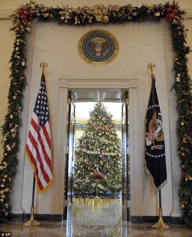 Main attraction: The official White House Christmas tree, an 18ft 6in Frasier fur from Jefferson, North Carolina, trimmed with ornaments decorated by children of military families