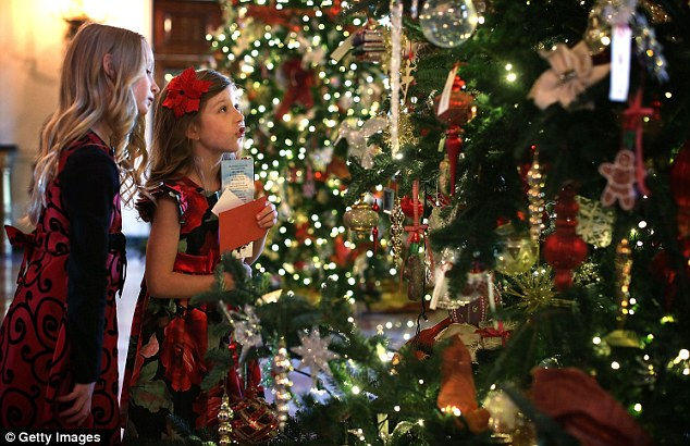 Magical display: Lauren Ray (far left) and Olivia Marlow of Northern Virginia look at ornaments on a Christmas tree in the White House