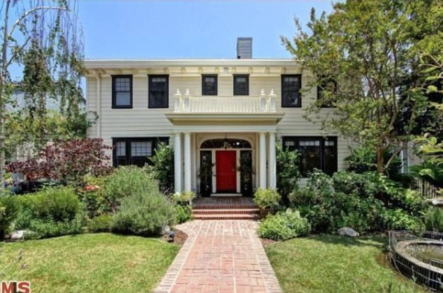 At the reddy: With its white paint, black trim and eye-catching door the house is decorated in a classic style