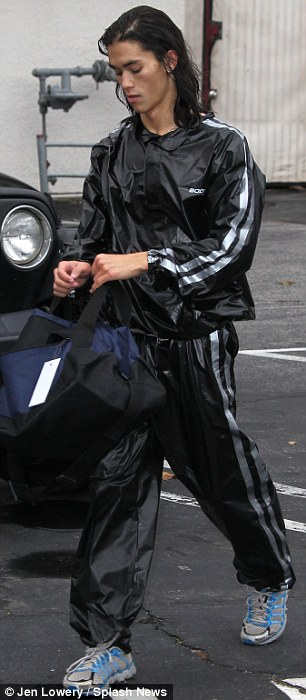 Covered up: He was happy to wear his tracksuit until he realised there was a chance for cheap publicity