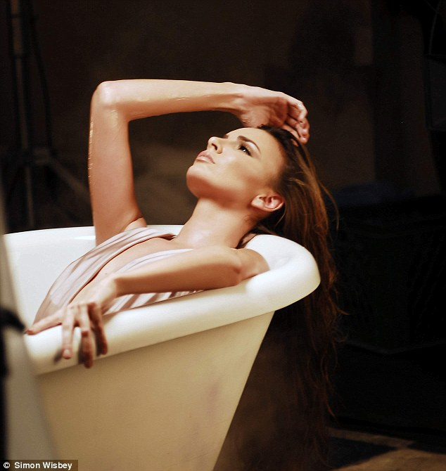 Just chilling in the tub: Nadine Coyle gives her best face in the music video