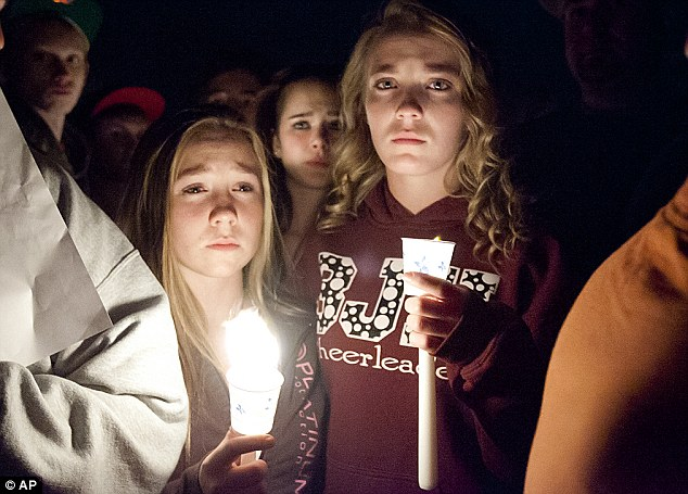 Mistreated: Students mourn during a vigil for the 14-year-old boy who they say was bullied by dozens of classmates