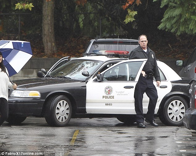 Police protection: Cops were standing by as Halle arrived at school with her daughter