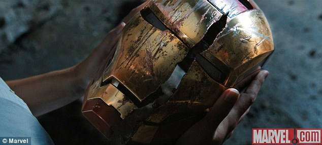 Hold your head high: Iron Man's famous red and gold helmet is massively damaged following an attack