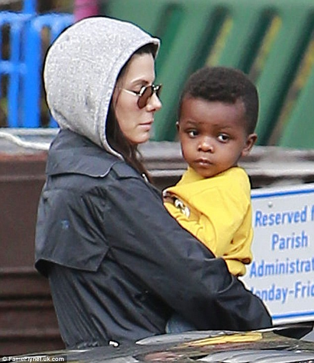Ray of sunshine: Sandra Bullock was spotted picking up her son Louis from school in Studio City on a gloomy, drizzly Friday