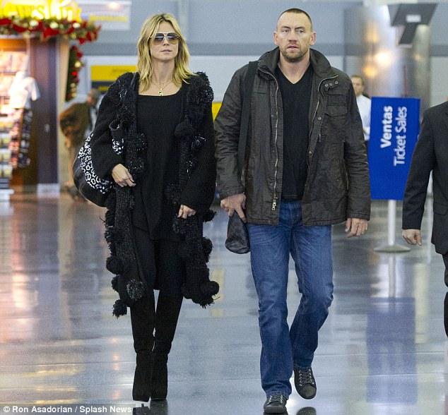 Inseparable: Heidi Klum and her boyfriend Marin Kristen arrived at JFK airport together on Saturday