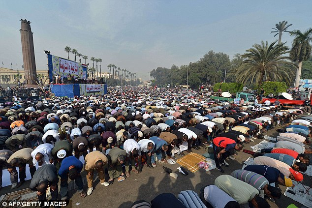 muslim extremist responsible for rapes and beatings pray to pagan moon god allah  Muslim Brotherhood supporters perform a prayer as they stage a rally in front of Cairo's University
