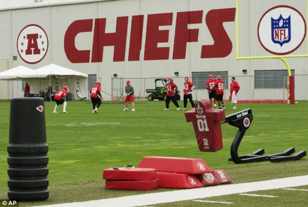 Upon arriving at the Arrowhead Stadium complex, police witnessed a black male in a car with a handgun to his head talking to two Chiefs officials