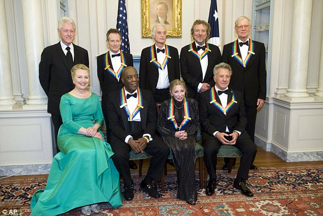 That's better: From left, former President Bill Clinton, Secretary of State Hillary Rodham Clinton join the 2012 Kennedy Center Honorees John Paul Jones, Buddy Guy, Jimmy Page, Natalia Makarova, Robert Plant, Dustin Hoffman, and David Letterman