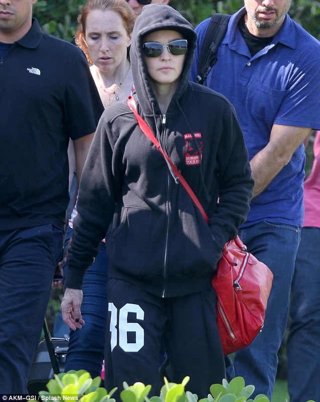 Living the high life: Madonna and her staff went for a helicopter ride in Rio de Janeiro on Sunday