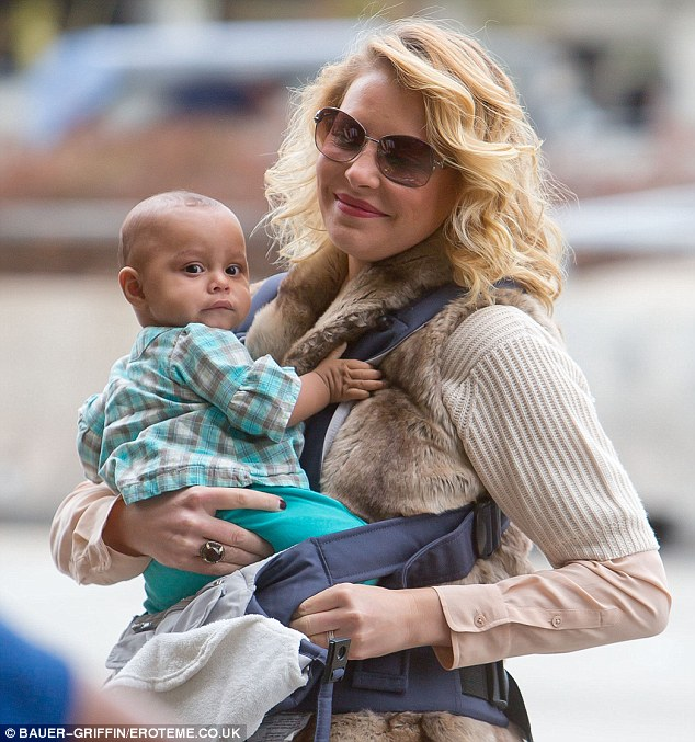 Besotted: The glamorous actress adopted baby Adelaide in April and the pair are inseparable