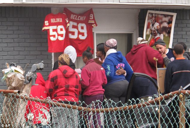 Grieving: Belcher's friends and relatives gathered outside his family home in West Babylon, New York