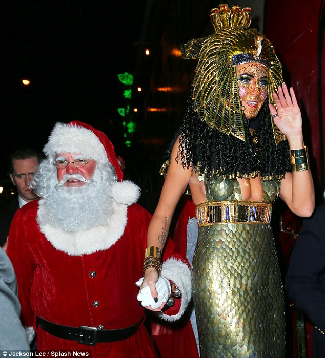 She's with Santa: Rather than parading her new boyfriend and bodyguard Martin Kristen down the red carpet, Klum escorted a rosy-cheeked, Santa Claus