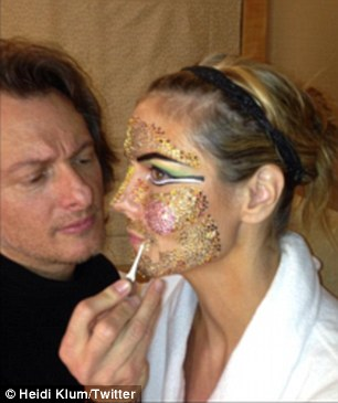 Bedazzled: The German-born 39-year-old had literally had hundreds of coloured rhinestones glued to her face prior to arriving at the venue