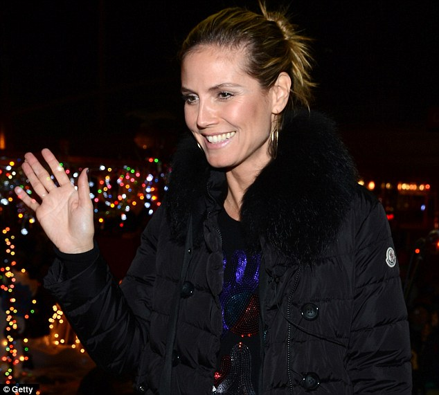 In the holiday spirit: Heidi was full of good cheer as she waved at locals as she went about her good work
