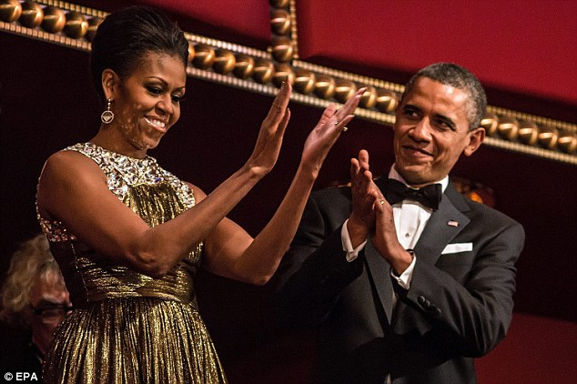 Here's to you: President Obama and first lady Michelle applaud on the balcony as they attend the 2012 Kennedy Center Honors at the Kennedy Center on Sunday night