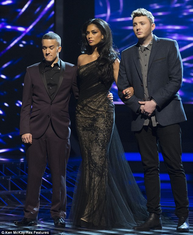 Her boys: Nicole looks tense as she awaits the final judgement from the public on Sunday evening