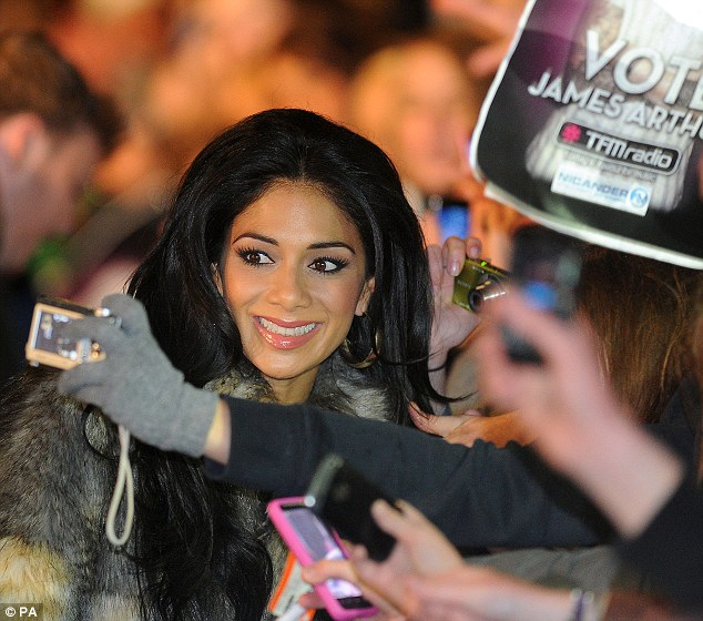 Doing her bit! Nicole grins for waiting fans outside the town hall on Tuesday evening