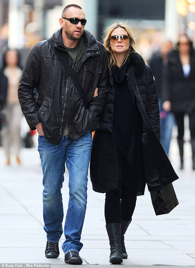 Arm-in-arm: The couple appeared closer than ever as they took a romantic afternoon walk