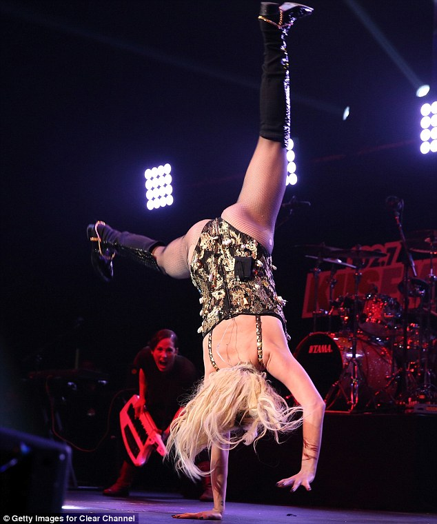 Rock and rolling: The singer performed a cartwheel as she entertained the crowds on Monday night