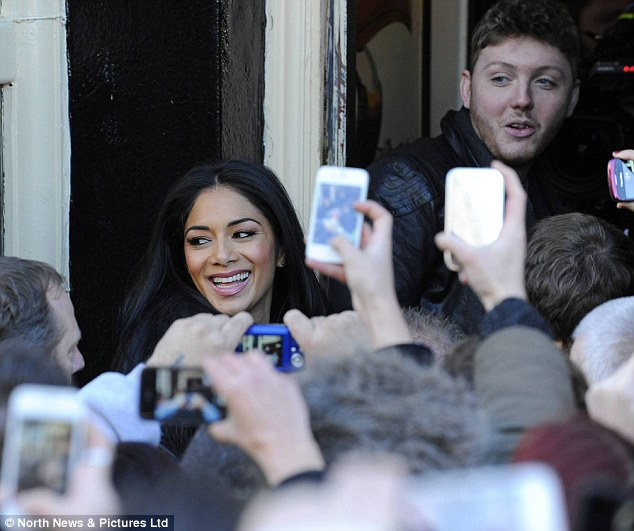 Nice to see you: The crowds of people brought out there mobile phones to get pictures of James and Nicole