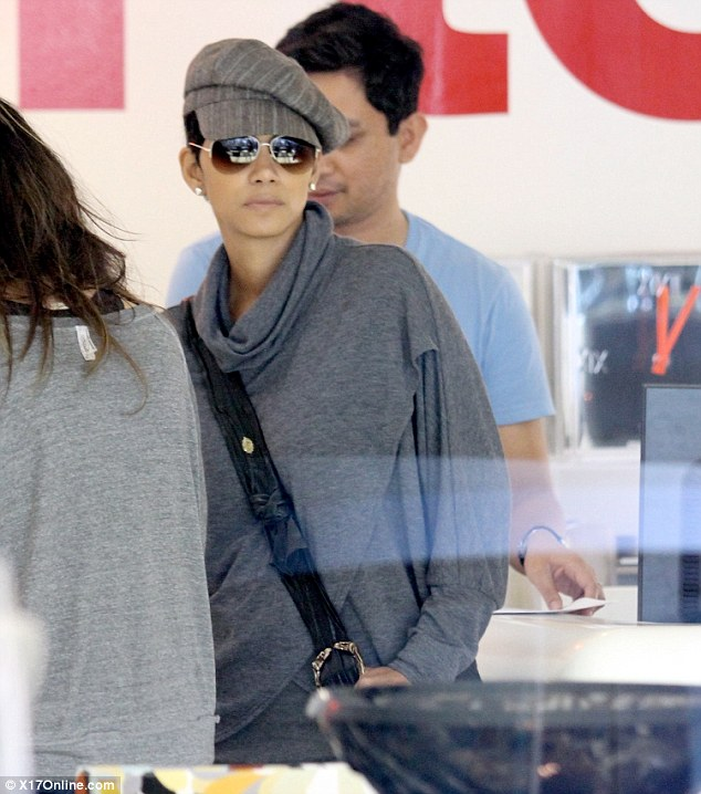 Retail therapy: Halle Berry takes her mind off the drama of the past weeks and hits the shops with a female pal