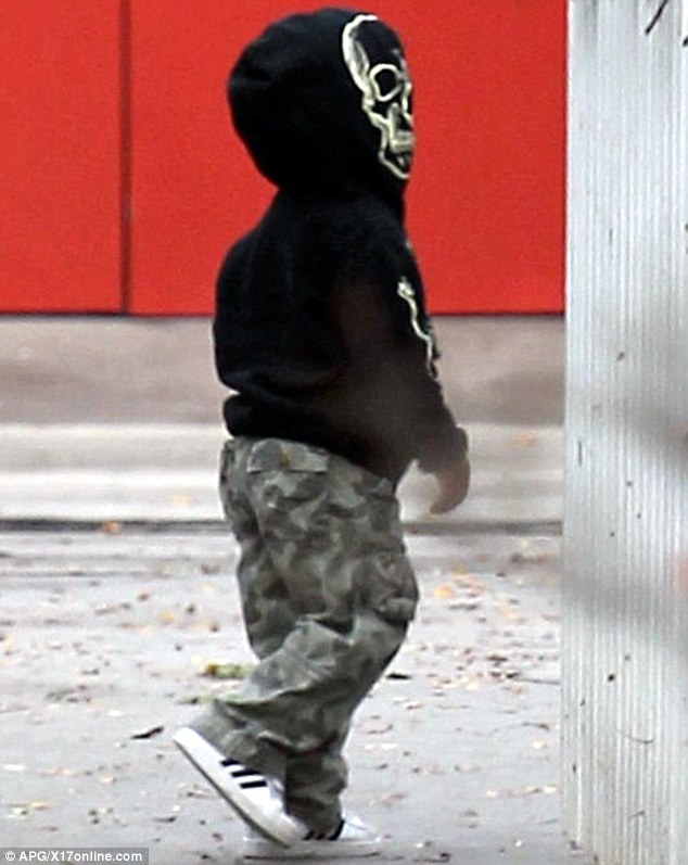 Going incognito: Little Louis Bardo Bullock looked simply adorable as he disguised himself in a skull-detail hoodie and camouflage trousers on Tuesday
