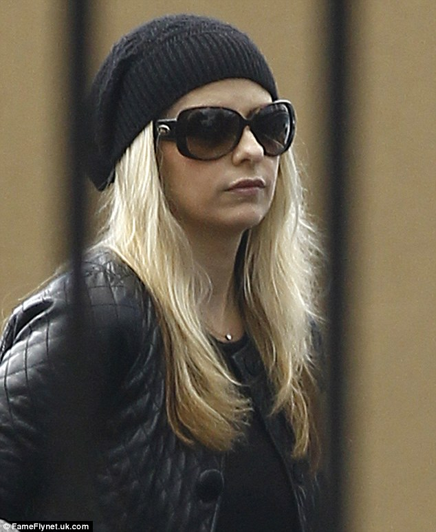 Covering up: The 35-year-old hid her eyes behind a pair of sunglasses as she wore a black beanie
