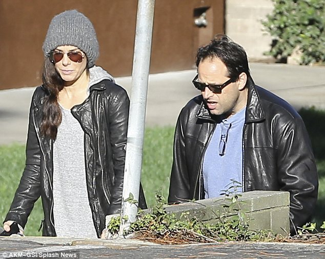 Making friends: Sandra, who was just named the fourth most overpaid actor by Forbes, was also seen chatting to a man