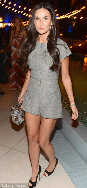 Geek chic: Demi wore a grey playsuit with a pair of black heels and thick-rimmed glasses for the party