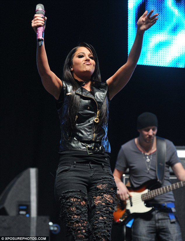 Live It Up: In spite of her fashion mishap, Tulisa seemed to be having a whale of a time as she performed a set of her hit tracks
