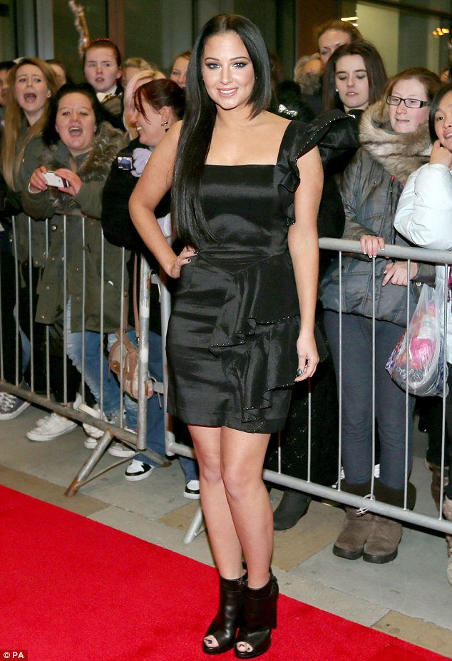 That's one way to get attention: Tulisa flashed the flesh in a tight black satin dress as she attended an X Factor photo call in Manchester on Thursday night