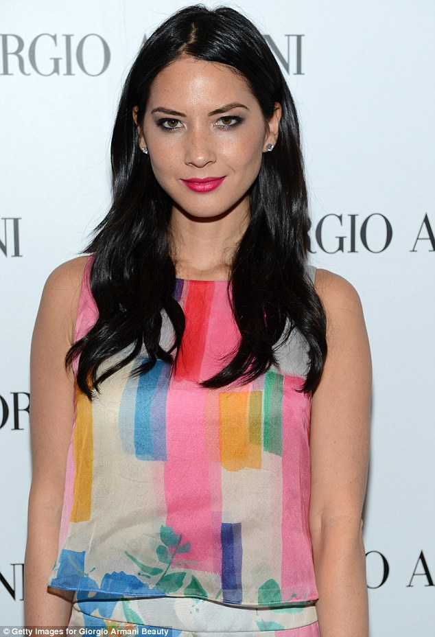 Candy-coloured: Olivia Munn looked incredible in her lively multi-coloured gown at the Giorgio Armani Beauty Luncheon in Beverly Hills on Wednesday